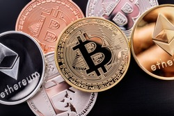 Stacked cryptocurrency coins (Bitcoin, Ethereum, Litecoin)