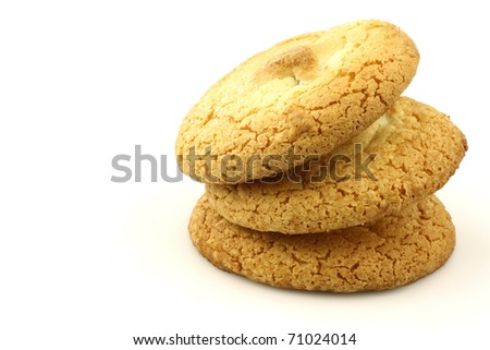 "stacked Dutch cookies called ""bitterkoekjes"" on a white background"