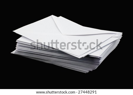 Stacked envelopes isolated on black