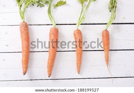 stacked fresh carrots on white background, vegetables