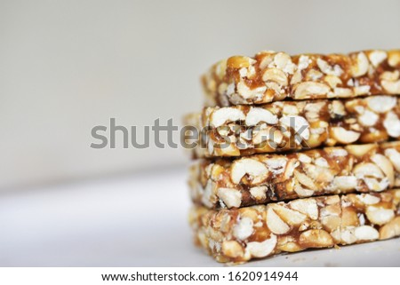 Stacked groundnut jaggery Chikki on the white background