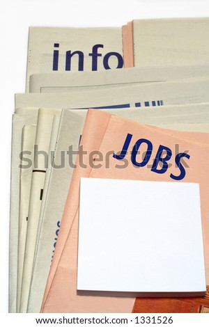 Stacked jobs newspapers on white background