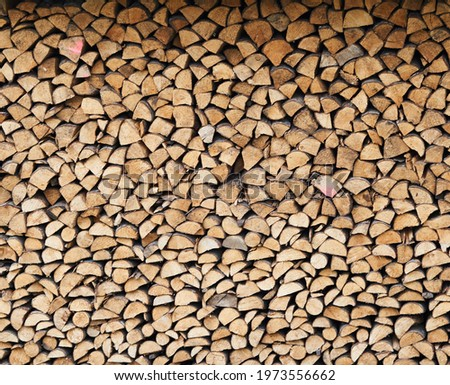 stacked loggs of fire wood texture background . High quality photo Foto d'archivio ©