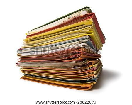 stacked multicolored file folders isolated on white, wide-angle view