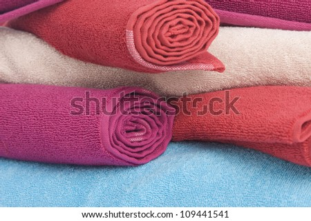 stacked of colorful towels on a white background