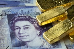 Stacked of gold bar on  banknote, GBP or pound with gold bar