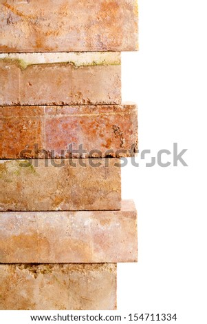 Stacked old clay bricks border isolated on white background