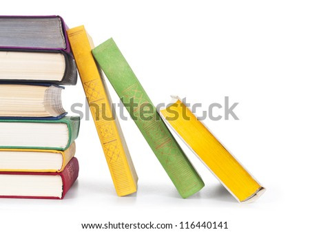 Stacked old colorful books on white background