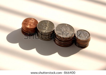 Stacked pennies, nickels, quarters and dimes