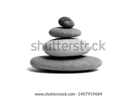 Stacked smooth grey stones. Sea pebble. Balancing pebbles isolated on white background