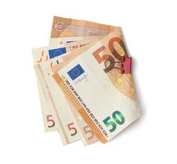 stacked stack of paper notes of the European Union, face value 50 euros, money isolated on a white background