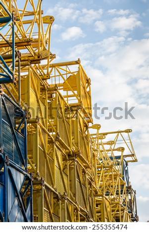 Stacked steel frames of old building cranes