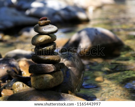 Stacked stone on the river.