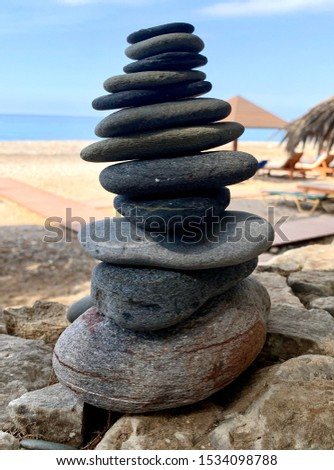 Stacked stones on sunny beach. Balance and tranquility concepts.
