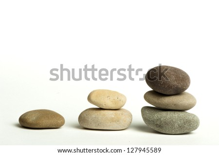 Stacked stones white isolated. Studio shot .