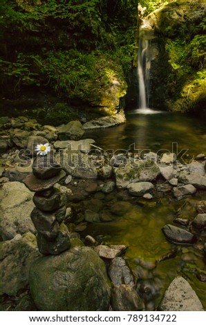 Rock Zen Stack in front of waterfall  Images and Stock
