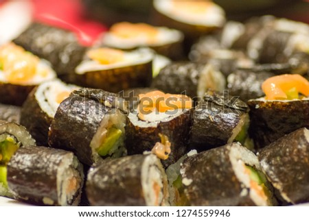 stacked sushi portions on a plate