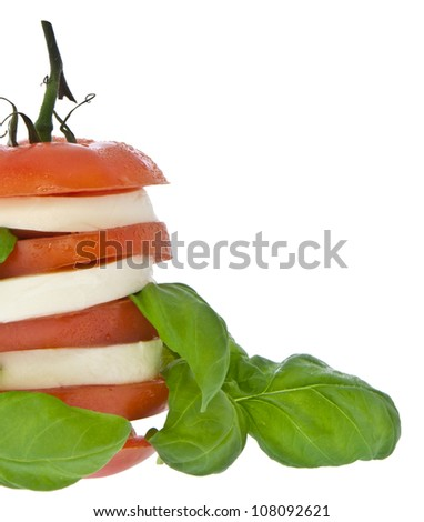 Stacked tomato with mozzarella and fresh basil isolated on white (with clipping path)