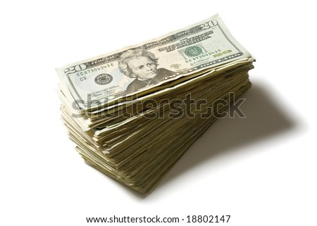 Stacked twenty dollar bills isolated on a white background