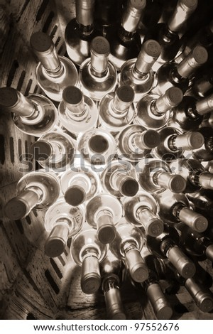 stacked up wine bottles in the wine cave