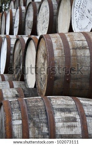 stacked whiskey barrels, Ben Nevis Distillery, Scotland - stock photo