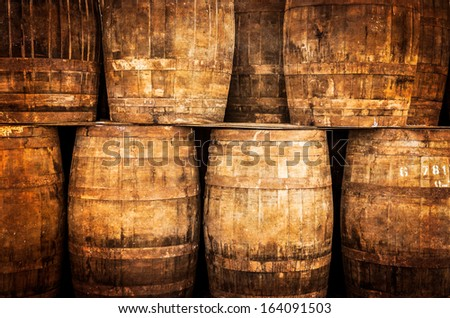 Stacked whisky barrels in monochrome vintage style