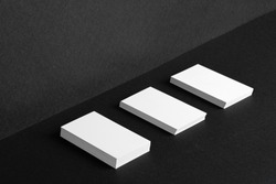 Stacked white businesscards for branding identity on black background, copy space