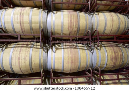 stacked wine barrels to ferment the wine, La Rioja, Spain - stock photo