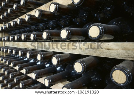 stacked wine bottles to ferment the wine, La Rioja, Spain