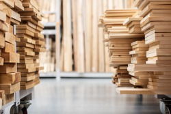 stacked wooden boards in a woodworking industry. stacks with pine lumber. folded edged board. wood harvesting shop. timber for construction