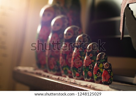 stacking dolls or Russian dolls with morning sun  light from windows #1248125029