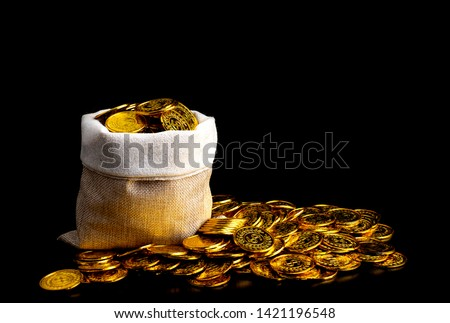 Stacking gold coin in treasure sack on black background, Money stack for business planning investment and saving future concept #1421196548
