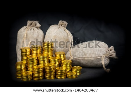 Stacking gold coin in treasure stack at black background #1484203469