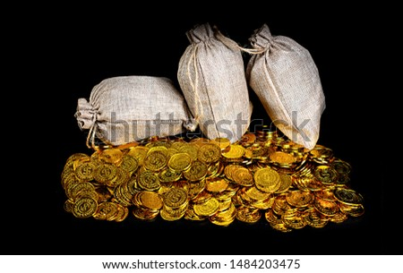 Stacking gold coin in treasure stack at black background #1484203475