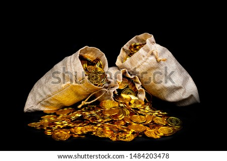 Stacking gold coin in treasure stack at black background #1484203478