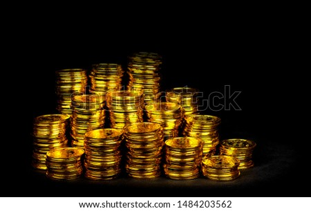 Stacking gold coin in treasure stack at black background #1484203562