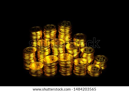 Stacking gold coin in treasure stack at black background #1484203565