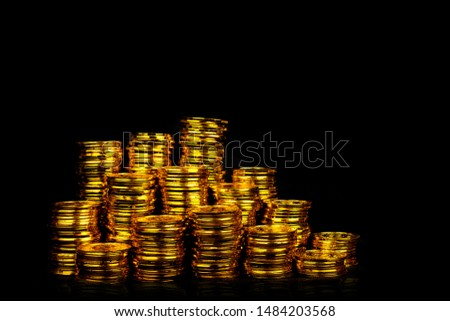 Stacking gold coin in treasure stack at black background #1484203568
