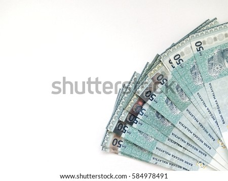 Hand holding Indian rupee notes against… Stock Photo
