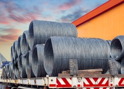 Stacking of wire rod on truck for delivery to  customer. Pile of wire rod or coil on truck for industrial usage .