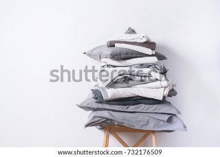 stacks monochrome gradient white gray black bed linen textiles clothing background pile concept