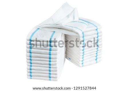 Stacks of adult diapers isolated on white background. Health care for elderly and bedridden people with urinary incontinence