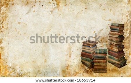 Stacks of antique books in the corner of a grunge background. Copy-space for your own text.