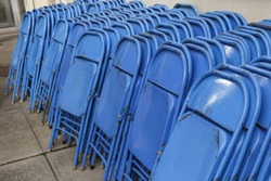 stacks of blue folding chairs