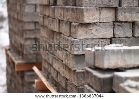 stacks of bricks stacked on a pallet #1386837044