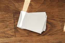 Stacks of businesscards with copy space on wooden background