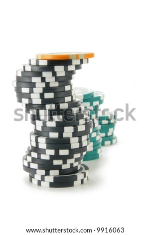 Stacks of casino chips isolated over a white background. - stock photo