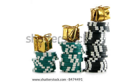 Stacks of casino chips with golden boxes on the top isolated over white background