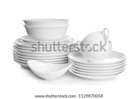 Stacks of ceramic dishware on white background