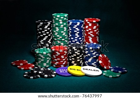 stacks of chips for poker with buttons of dealer, small blind and big blind